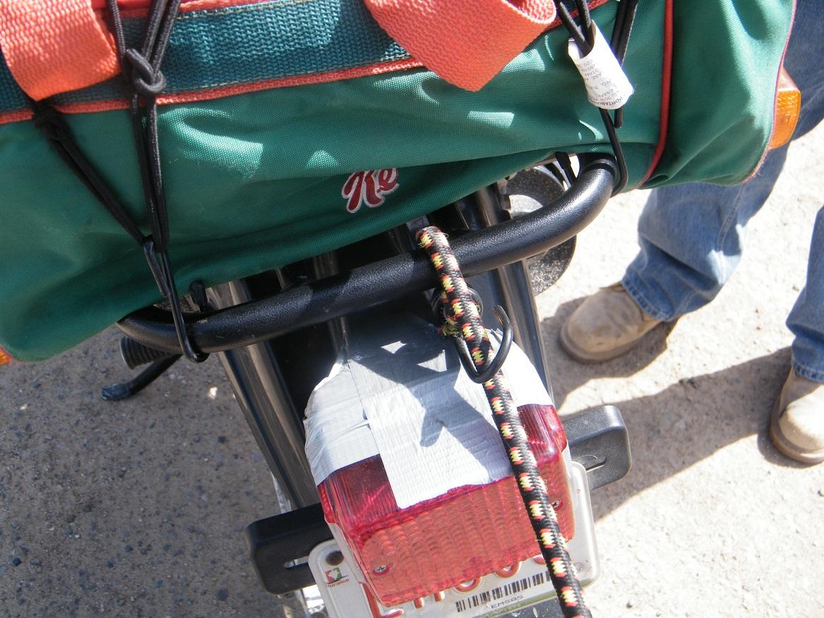 Dispositivo posicionador de empuje con cinta